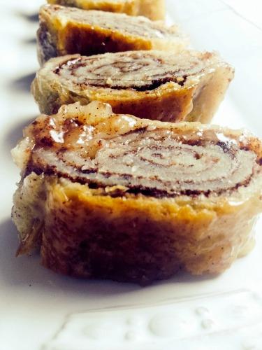 Cinnamon swirl pastry on a white platter