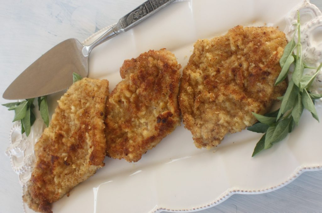 Kotlet Schabowy, 3 pieces on a white plate