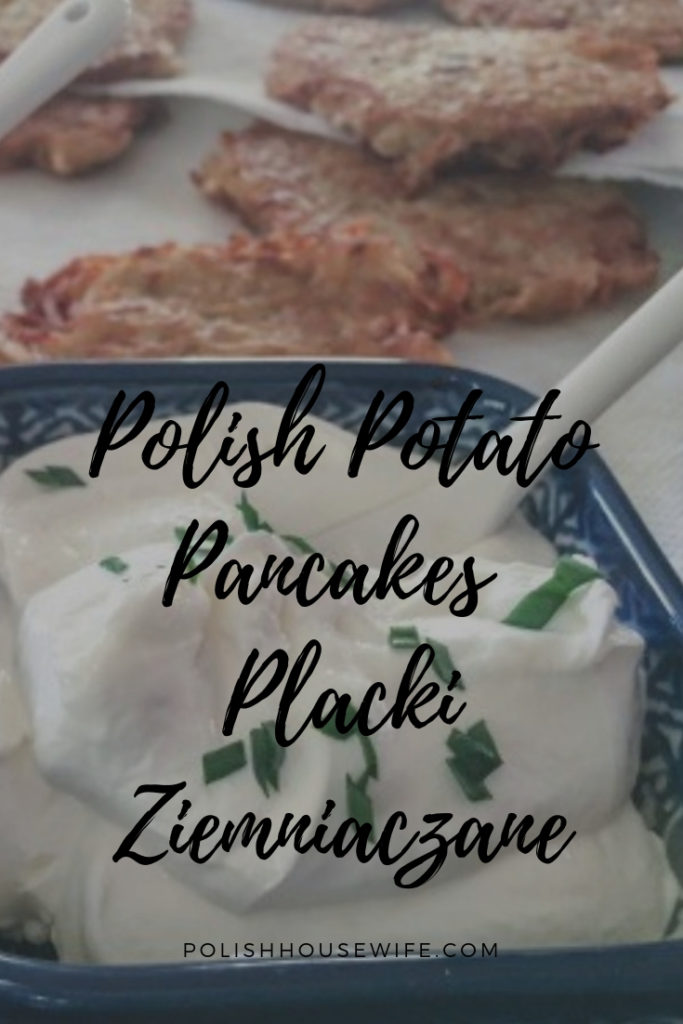 potato pancake and sour cream topped with chives in polish pottery