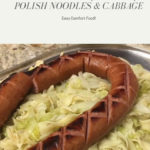 Noodles and cabbage topped with Polish sausage