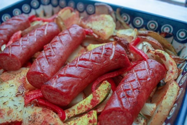 roasted vegetables and polish sausage in Polish pottery baking dish