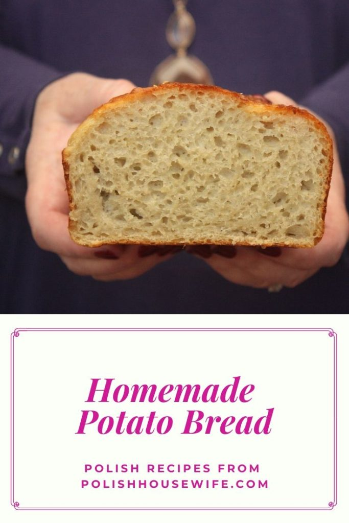 a woman holding a cut loaf of polish potato bread