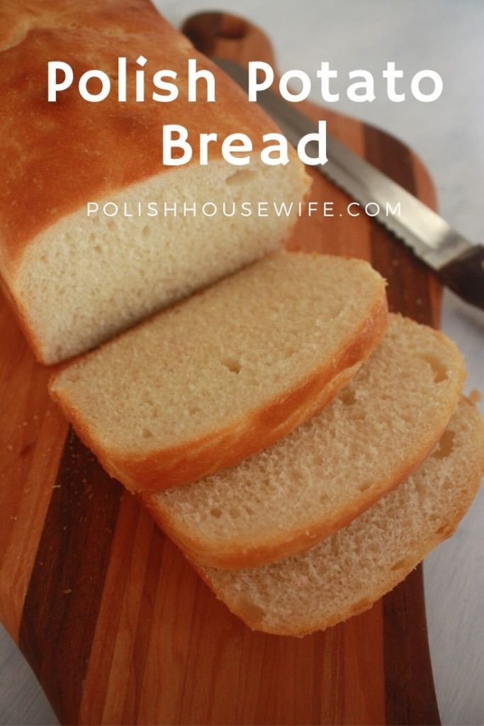 a partially sliced loaf of polish potato bread on a cutting board