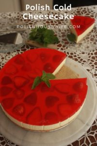 a no-bake cheesecake topped with strawberries and red gelatin served on a crocheted tablesloth
