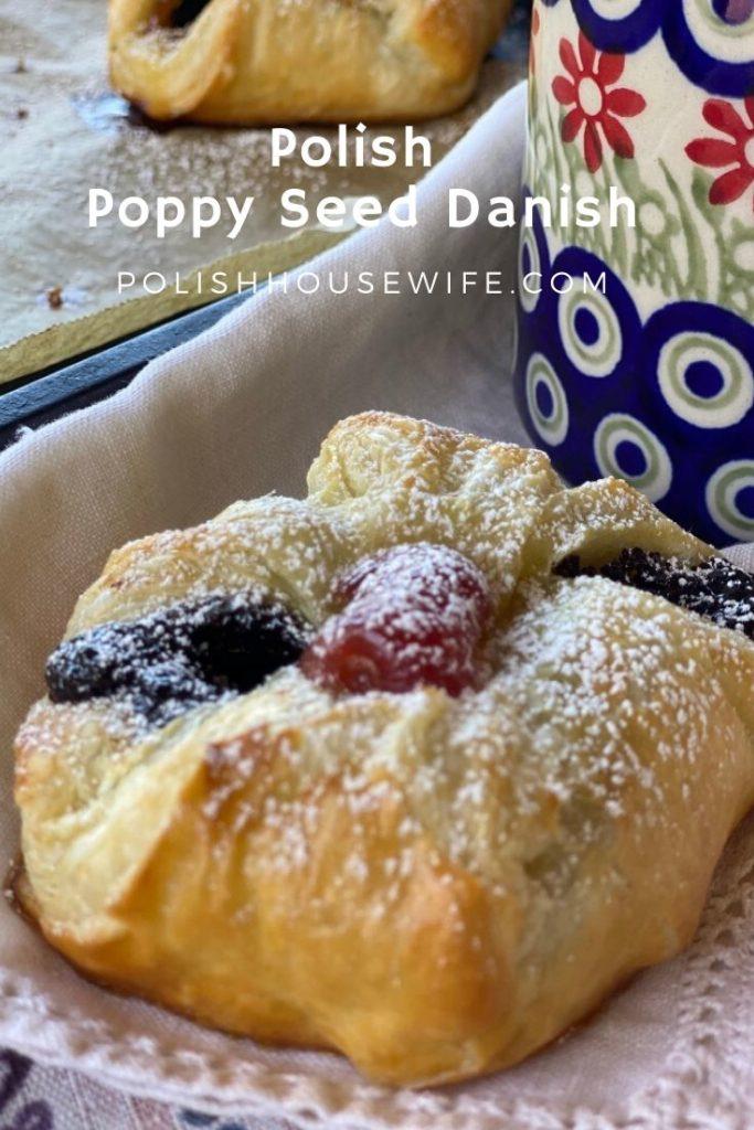 Polish poppy seed danish pastry on a napkin beside a Polish pottery mug.