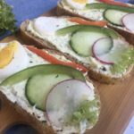 Polish kanapki, open face sandwiches on serving board
