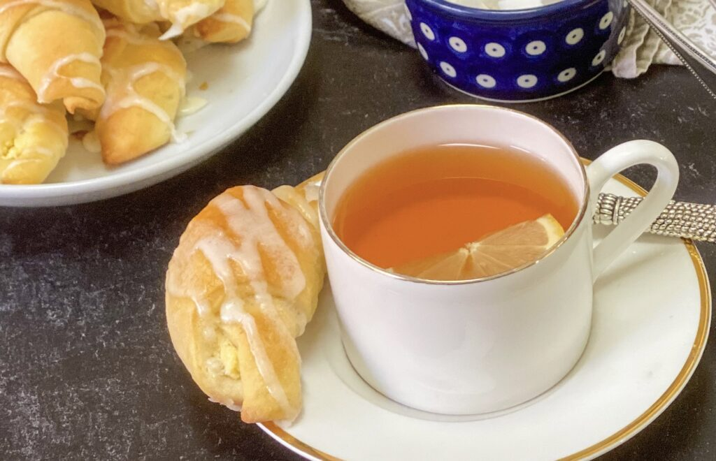 Polish Yeast Croissans with Cheese Fillings with a chup of tea and lemon.