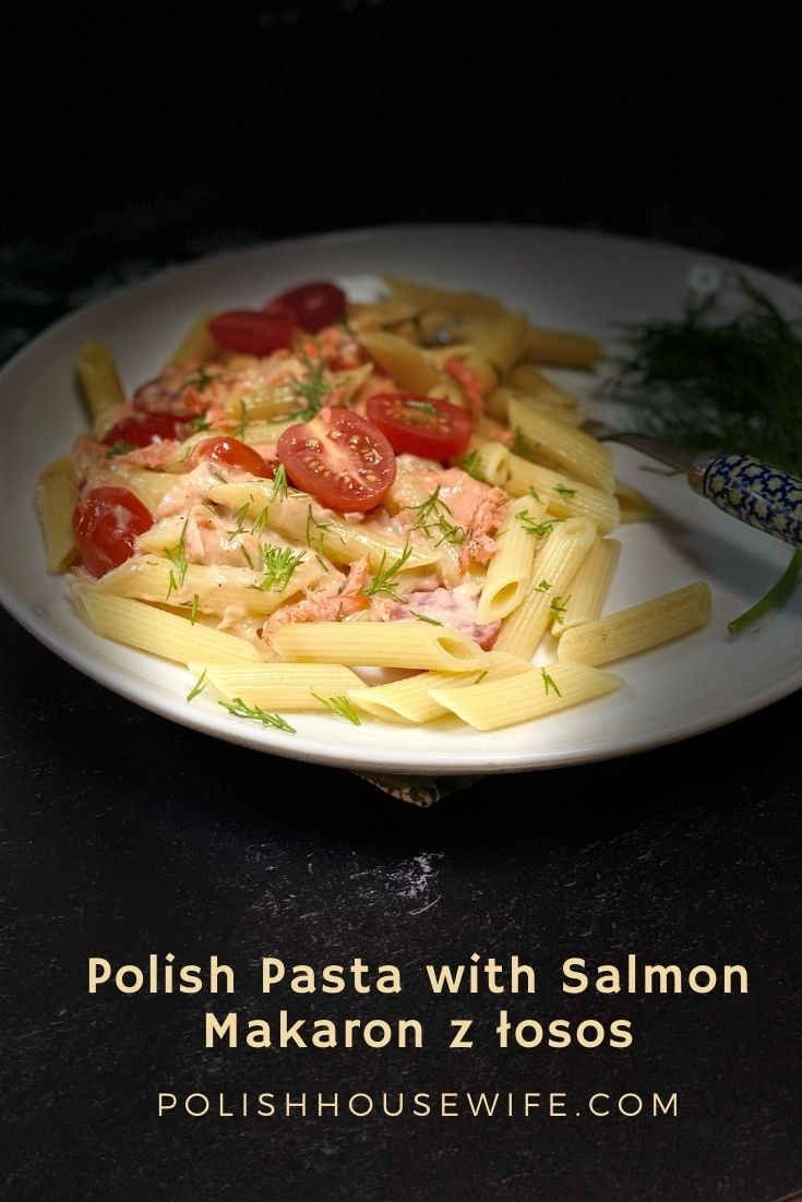 Polish pasta with salmon on a white plate