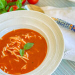 Polish tomato soup with noodles in a white bowl