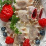 mixed berry pierogi on a white plate